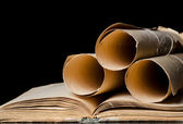 Many ancient scrolls and old books — Stock Photo