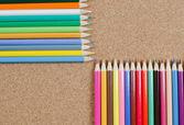 Colour pencils on сorkboard — Stockfoto