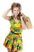 The beautiful girl in a summer dress isolated — Stock Photo
