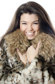 Beautiful girl in a fur hood — Stock Photo