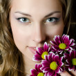 The girl with beautiful hair with pink  chrysanthemum — Stock Photo