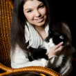 The girl with a cat in an armchair - Stock Photo
