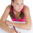 The young girl writes to writing-books — Stock Photo