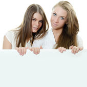 Two girl-friends isolated on white background — Stock Photo