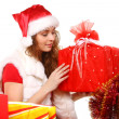 Stock Photo: Young girl with Christmas gifts