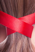 Ribbon in a hair — Stock Photo