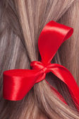 Red bow in a hair — Stock Photo