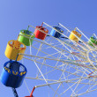 Wheel of review in the park on blue sky background - Foto Stock