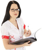 Female doctor in glasses with clipboard — Stockfoto