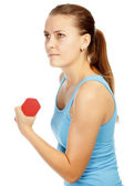 Girl with barbells — Stock Photo