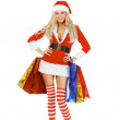 Woman in christmas costume with shopping bags — Stock Photo