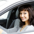 Female driver smiling to you — Stock Photo
