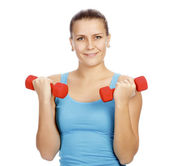 Pretty woman with red barbells — Stock Photo