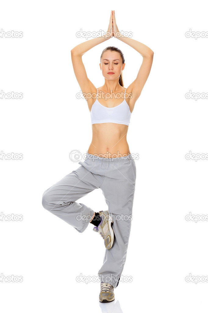 Portrait of beautiful woman working out yoga exercise (tree pose), isolated on white background  Stock Photo #8495804