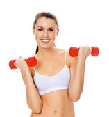 Pretty girl with red barbells posing against white background — Stock Photo
