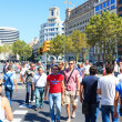 Many of tourists strolling across the center of Barcelona, Spain - Stock Photo