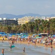 Stock Photo: Many of tourists rest along Salou beach on September 22, 2011