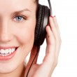 Pretty young girl listening music — Stock Photo