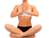 Muscular woman doing yoga exercise, isolated on white — Stock Photo
