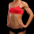 Muscular female body against black background — Stock Photo #9092652