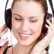 Pretty girl listening music and smiling to you — 图库照片