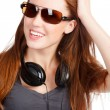 Stock Photo: Pretty girl with headphones smiling