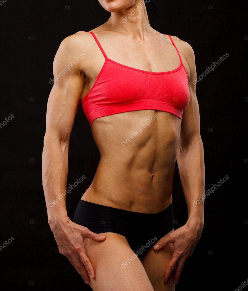 Muscular female body against black background. — Stock Photo #9362305