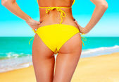 Closeup of a female backside in a yellow swimsuit — Stock Photo