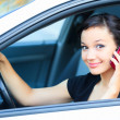 Pretty asian girl in a car talking by mobile telephone — Stock Photo