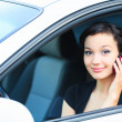 Royalty-Free Stock Photo: Pretty asian girl in a car talking by mobile telephone