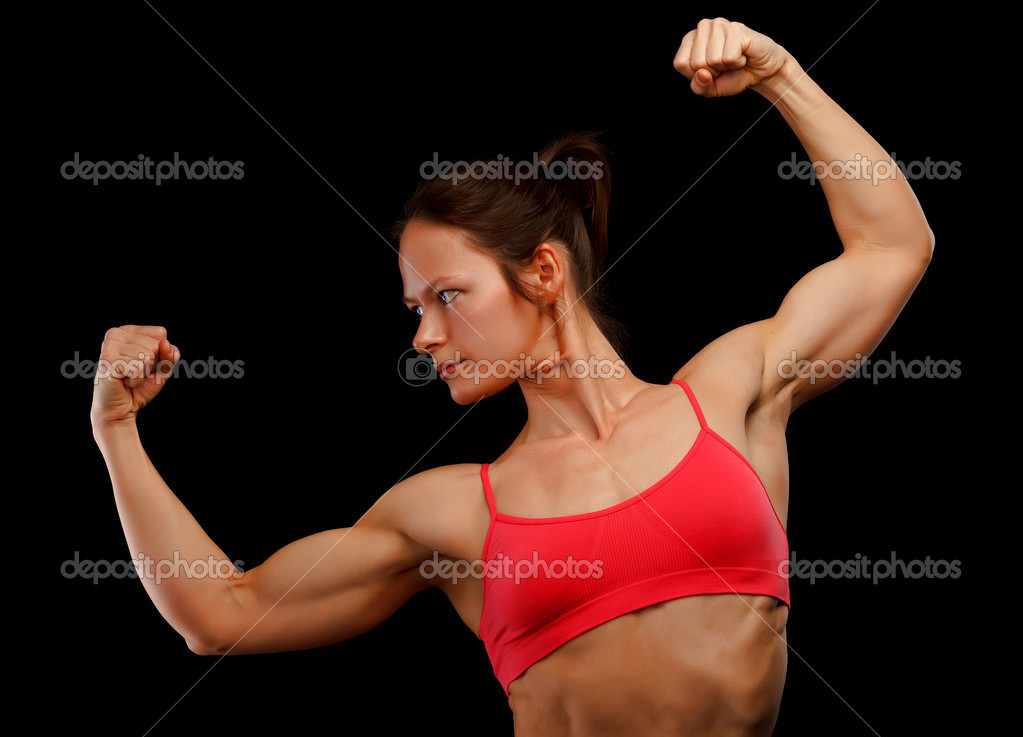 Female athlete posing against black background — Stock Photo #9713861