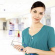 Cute female doctor in a hospital. — Stock Photo