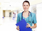 Beautiful female doctor or nurse — Stock Photo