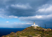 Lone lighthouse on the hillside. Mykonos.Greece — Stock Photo