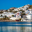 Stock Photo: Famous red boat and church in bay of Mykonos. Greece.