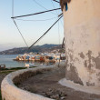 Stock Photo: Famous windmill of Mykonos on background of Little Venice at sunset.