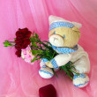 Sad love teddy bear with flowers and gifts. — Stock Photo