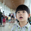 Little girl at the airport terminal — Stock Photo
