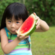 Постер, плакат: Happy child with watermelon