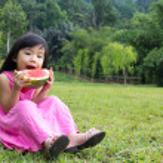 Happy child with watermelon — Stock Photo #9736309