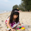 Little girl playing sand - Stock Photo