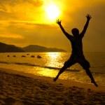 Man jumping on beach sunset — Stock Photo