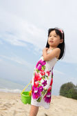 Portrait of little girl on beach — Stock Photo