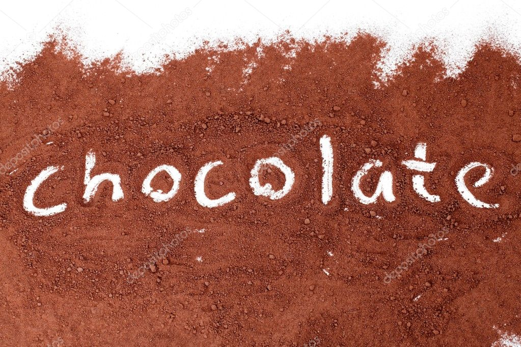 Chocolate written in cocoa powder — Stock Photo #10573838