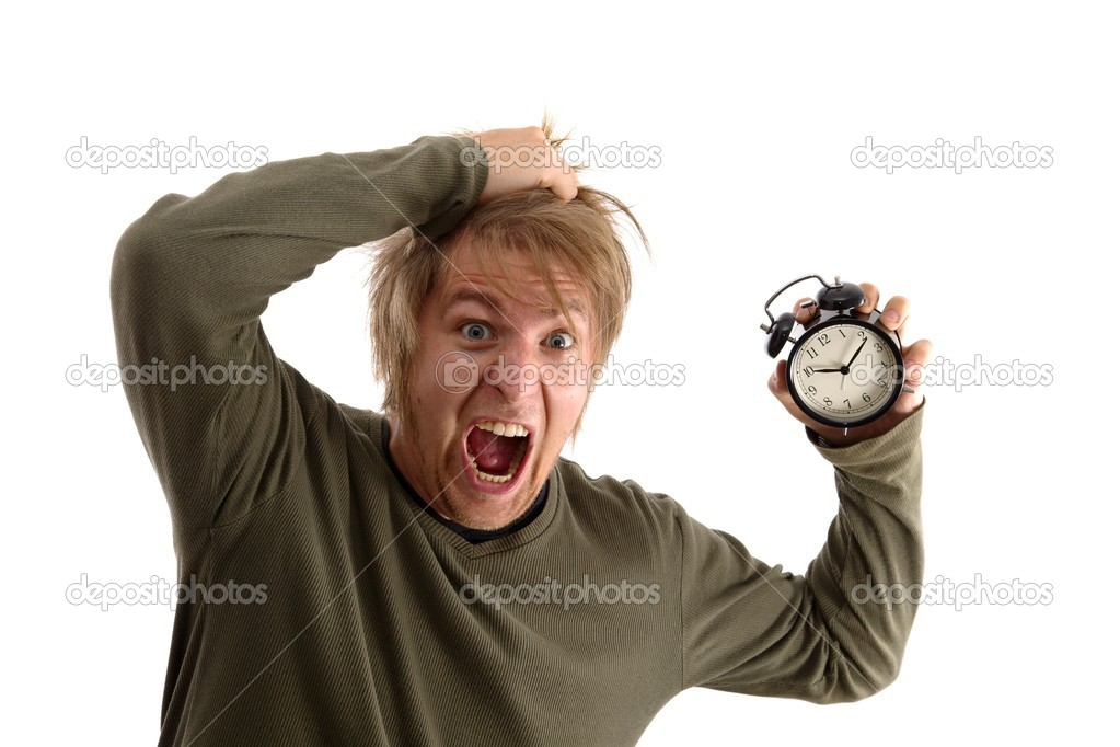 Outraged man with alam clock in hand — Stock Photo #9589642