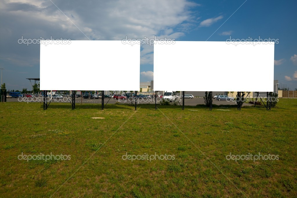 Blank billboard signs at a parking lot — Stock Photo #9724203