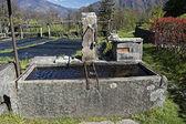 Stone fountain at mountain — Stock Photo