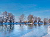 Snow-covered winter river in sunny day — Stock Photo