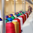 Stock Photo: Colorful of cone threads from textile factory
