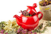 Red teapot, mortar and pestle, sack with healing herbs — Stock Photo